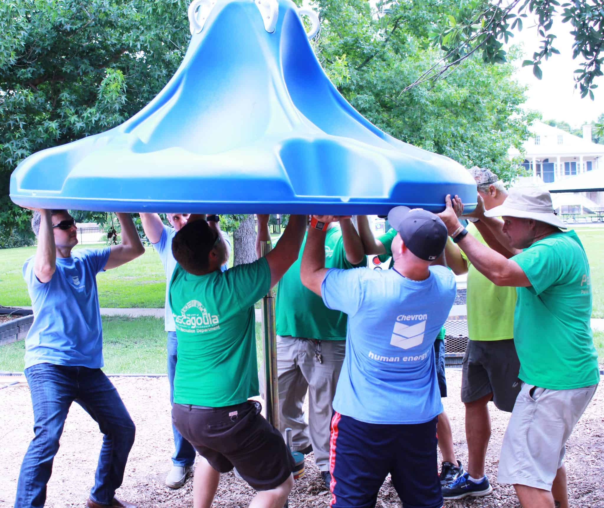 installing-4 Volunteers, City Partner to Make Playground More Accessible